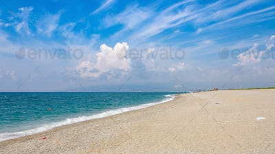 Panoramic view of a gravel beach in Calabria