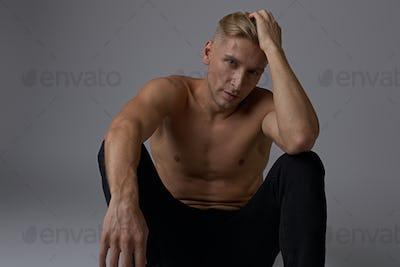 Portrait sitting man naked torso posing