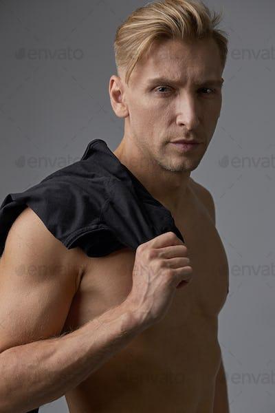 Portrait handsome man with naked torso