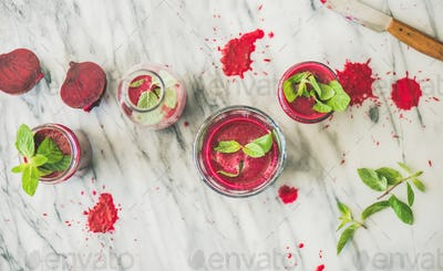Fresh beetroot smoothie in glasses over marble background