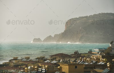 View over the stormy sea and castle hill of Alanya