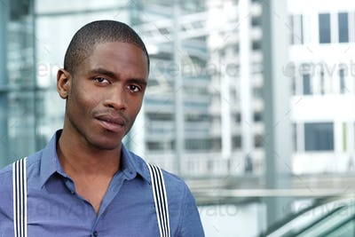 young african businessman in blue shirt and suspenders