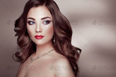 Brunette woman with long shiny wavy hair