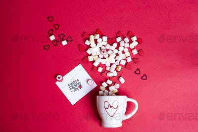 Valentine's Day with cup coffee and wooden hearts with marshmallow