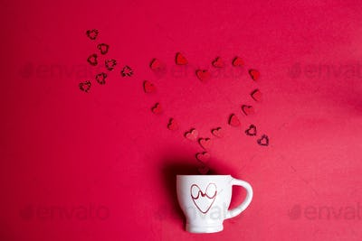 Valentine's Day with cup coffee and wooden hearts