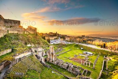 Volterra, roman theatre ruins at sunset. Tuscany, Italy.