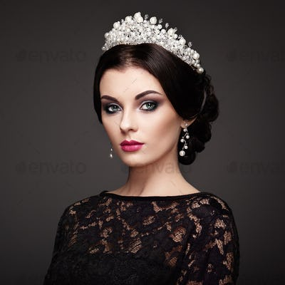 Fashion portrait of beautiful woman with tiara on head