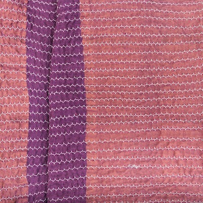 pink textile background from stitched strips