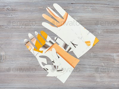 paper models of gloves on wooden table