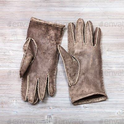 pair new hand-made gloves on table