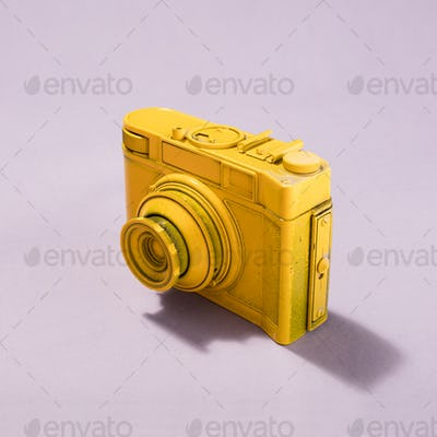 Camera standing on pastel pink background