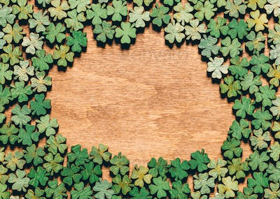 Four-leaf clovers laying on wooden floor