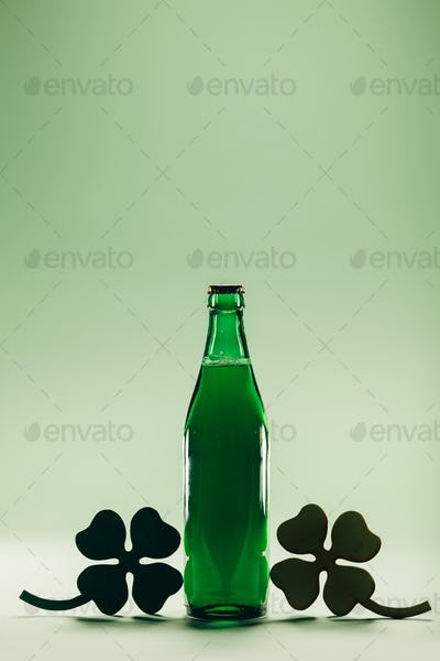 Green beer bottle. St. Patric's Day decoration