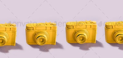 Yellow cameras standing in a row