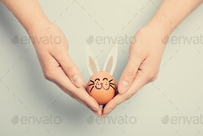 Woman's hand holding an Easter bunny