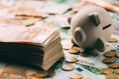 Piggy moneybox with euro cash