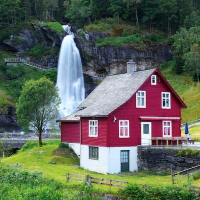Red house near Steinsdalsfossen waterfall