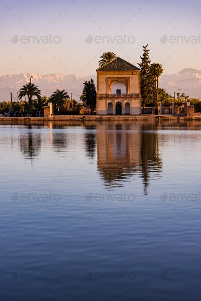 Menara Gardens Pavilion reflect in water at sunset,Morocco
