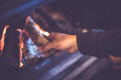 Man kindles a fireplace
