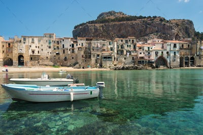 Boats and clear water in Cefalu town