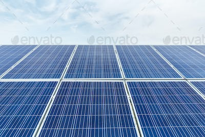solar panel closeup with blue sky in cloudy