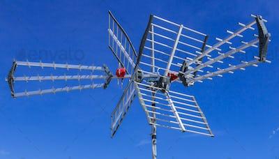 Tv antenna against blue sky