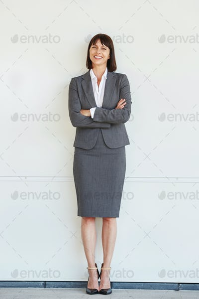 Full body portrait of professional business woman