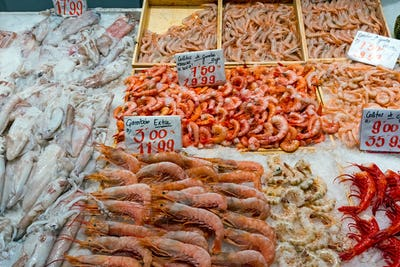 Prawns and squid for sale at a market