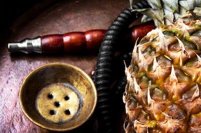 Stylish oriental shisha with pineapple