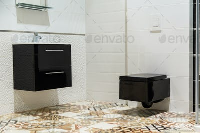 Luxury design of bathroom with black toilet bowl and washbasin