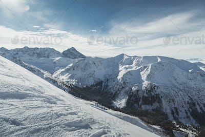 Wide view of the snowy peaks of the Tatry mountains on the border of Poland and Slovakia.