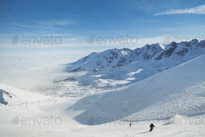 Skiing resorts. Snowy slopes in winter mountains