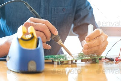 Technician repair circuit board.