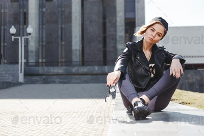 Fashionable hipster woman in black