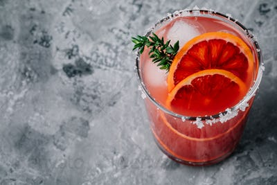 Blood Orange Margarita cocktail with ice and thyme