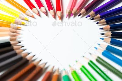 Color pencils arranged in a heart shape