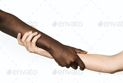 Hand holding hand isolated on background