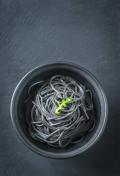 Bowl of pasta with squid ink