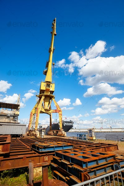 Yellow crane in a shipyard.