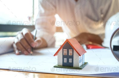 Home design concept,Architects are writing home plan.