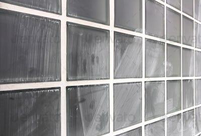 Wall of glass dirty blocks