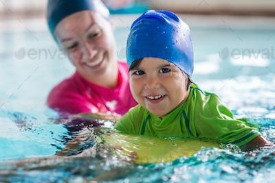 Little boy on swimming class