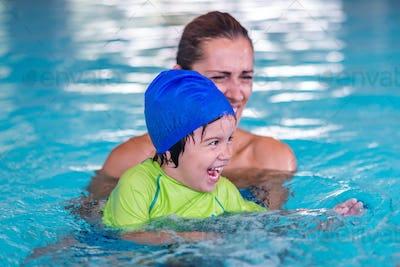 pool; class; boy; child; water; fun; little; swimming; activity;