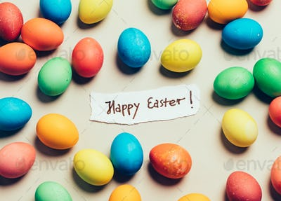 """Bunch of colorful eggs and """"Happy Easter"""" card"""
