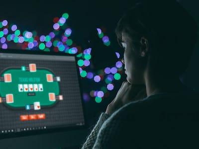 Woman playing online poker