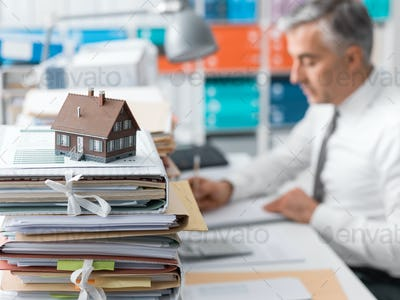 Real estate, mortgage loans and paperwork