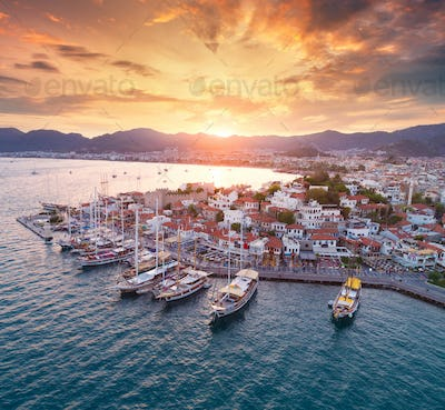 Aerial view of boats and yahts and beautiful city at sunset