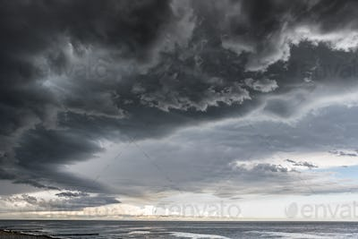 Approaching storm cloud with rain over the sea