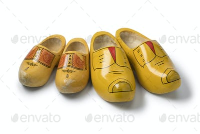 Two pairs of traditional yellow Dutch wooden shoes