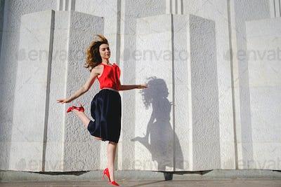 Cheerful woman jumping happy